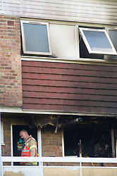 © Licensed to London News Pictures. 20/08/2019.<br /> Orpinton ,UK. Fire investigation officer. London Fire Brigade, Police and the London Ambulance Service are all in attendence this morning at a serious flat fire in Petten Grove, Orpington, South East London which has seen three people taken to hospital suffering from smoke inhalation one of the three is a child. A police cordon is in place as fire investigation officers work on scene. Photo credit: Grant Falvey/LNP