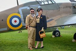 © Licensed to London News Pictures.09/09/2018. Goodwood. West Sussex, UK. <br /> The Goodwood motor circuit celebrates the 20th anniversary of the Revival.The Revival has become one of the biggest annual historic motorsport events in the world and the only one to be staged entirely in period dress. Each year over 150,000 people descend on this quiet corner of West Sussex to enjoy the three-day event.<br /> Pictured. Matthew Hartshorn and Kate Morrison from Coventry. <br /> Photo credit: Ian Whittaker/LNP
