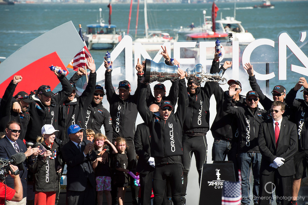 Oracle Team USA celebrate winning America's Cup 34. Jimmy Spithill holds aloft the Cup. 25/9/2013