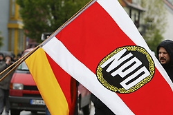 "May 4, 2019 - Sinsheim, Baden-Wuerttemberg, Germany - A right-wing protester carries a NPD party flag. Around 25 sympathisers of the German right-wing party NPD (National Democratic Party of Germany) marched through the city of Sinsheim under the motto ""For security and love of the homeland"", ahead of the upcoming European and local elections. They were confronted by a group of counter protesters from the alliance Sinsheim for diversity. (Credit Image: © Michael Debets/Pacific Press via ZUMA Wire)"