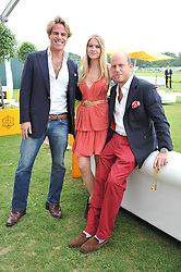 Left to right, The HON.ALEXANDER BRENNAN, ALICE FARQUHAR and CARLO CARELLO at the 2011 Veuve Clicquot Gold Cup Final at Cowdray Park, Midhurst, West Sussex on 17th July 2011.