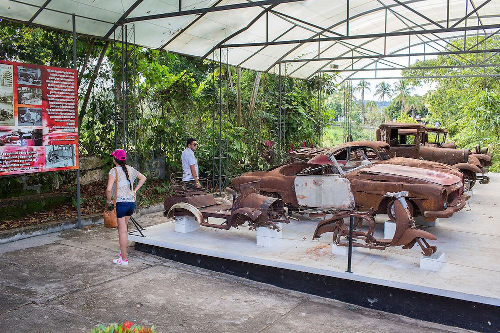 2015/11/21 - Puerto Triunfo, Colombia: Tourists look to the remains of the vintage car collection of Pablo Escobar that were destroyed when a bomb exploded outside Escobar's residence in Medellín, the Monaco building.  The Hacienda Nápoles was a 20sq kilometer property own by drug lord Pablo Escobar. In its splendor, the property had its own private airport, bull arena, kart racing circuit and even a private zoo that included many kinds of animals from different continents such as giraffes, ostriches, elephants, hippopotamuses, antelope, and exotic birds. After the death of Pablo Escobar in 1993, the family went into a legal struggle with the Colombian government over the property. Nowadays it is an leisure park, where most of Escobar presence disappeared. (Eduardo Leal)