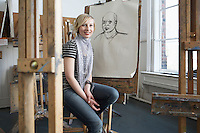 Portrait of smiling female art student in art studio