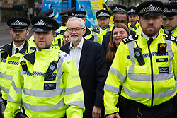 London, UK. 1st May, 2019. Jeremy Corbyn, Leader of the Opposition, leaves Parliament Square after noted anti-Brexit protester Steve Bray of SODEM (Stand of Defiance European Movement) questioned his policy on Brexit after the Leader of the Opposition spoke at a rally to coincide with the vote in Parliament on declaring a climate emergency.