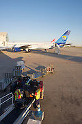 Palma de Mallorca Airport. My luggage being loaded onto our FlyNiki Airbus 321. Thomas Cook Boeing 757 in background.