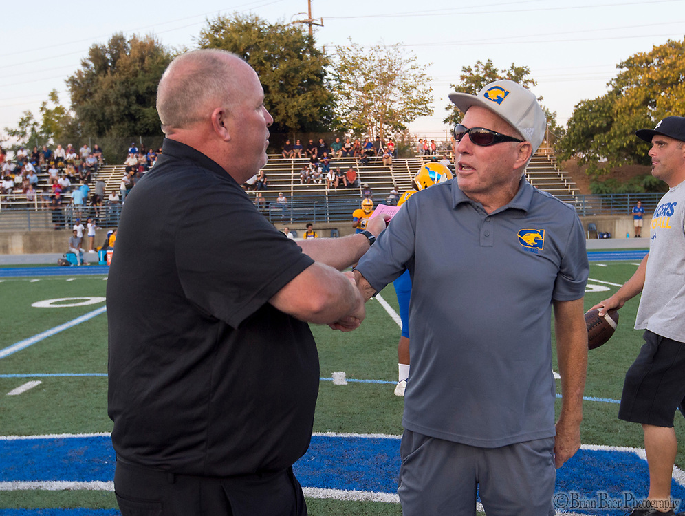 Capitol Christian Cougars head coach Casey Taylor, greets Grant Pacers head coach Mike Alberghini, before the game as the Capitol Christian Cougars host the Grant Pacers,  Friday Sep 8, 2017. photo by Brian Baer