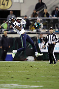 Seattle Seahawks wide receiver Paul Richardson (10) leaps and catches a 61 yard pass and run for a fourth quarter touchdown that cuts the Jacksonville Jaguars lead to 27-17 during the 2017 NFL week 14 regular season football game against the Jacksonville Jaguars, Sunday, Dec. 10, 2017 in Jacksonville, Fla. The Jaguars won the game 30-24. (©Paul Anthony Spinelli)