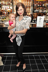 JASMINE GUINNESS and her daughter RUBY RAINEY at a brunch hosted by Zac Posen to launch the Belvedere Bloody Mary Brunch held at Le Caprice, 25 Arlington Street, London on 7th April 2011.