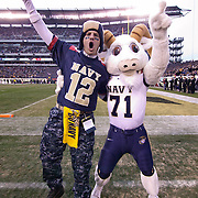 Navy Mascot Bill the Goat and a fan celebrate late in the 2nd quarter  at Lincoln Financial Field in Philadelphia Pennsylvania.