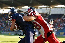 09.07.2011, UPC Arena, Graz, AUT, American Football WM 2011, Group B, Frankreich (FRA) vs Kanada (CAN), im Bild Paul Durand   (France, #12, QB ) gets stopped by Julien Hamel (Canada, #49, DB)// during the American Football World Championship 2011 Group B game, France vs Canada, at UPC Arena, Graz, 2011-07-09, EXPA Pictures © 2011, PhotoCredit: EXPA/ E. Scheriau