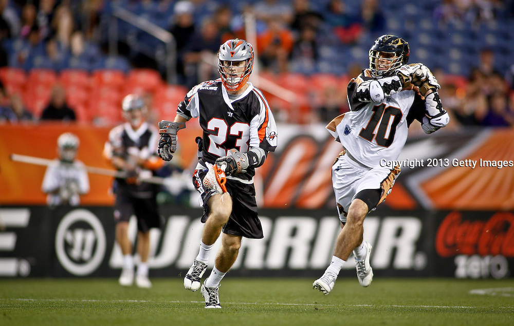 DENVER, CO - MAY 18: Drew Snider #23 of the Denver Outlaws tries to escape the pressure of Steven Boyle #10 of the Rochester Rattlers during their game at Sports Authority Field at Mile High May 18, 2013 in Denver, Colorado. The Outlaws won the game 20-7. (Photo by Marc Piscotty/Getty Images) *** Local Caption *** Drew Snider; Steven Boyle