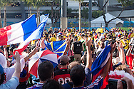 French fans in the foreground chant at Ecuador fans in yellow in the background outside the stadium before the 2014 FIFA World Cup Group E match at Maracana Stadium, Rio de Janeiro<br /> Picture by Andrew Tobin/Focus Images Ltd +44 7710 761829<br /> 25/06/2014