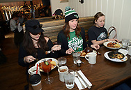 From left, Philadelphia Eagles fans Annie Whitney of East Hampton, New York, Molly Kitsch of West Chester, Pennsylvania and Autumn DiPietro of Allentown, Pennsylvania enjoy brunch at Pub & Kitchen Sunday, February 04, 2018 in Philadelphia, Pennsylvania. The pub added Bleeding Green Bloody Marys and Crispy Fried Brady Chicken to the menu. WILLIAM THOMAS CAIN / For The Inquirer