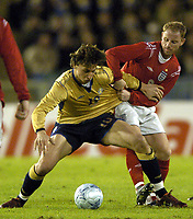 Photo: Richard Lane.<br /> Sweden v England. International Friendly. 31/03/2004.<br /> Nicky Butt battles with Zlatan Ibrahimovic.