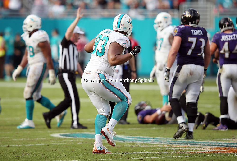 Miami Dolphins defensive tackle Ndamukong Suh (93) dances after the Dolphins stuff a key play during the 2015 week 13 regular season NFL football game against the Baltimore Ravens on Sunday, Dec. 6, 2015 in Miami Gardens, Fla. The Dolphins won the game 15-13. (©Paul Anthony Spinelli)