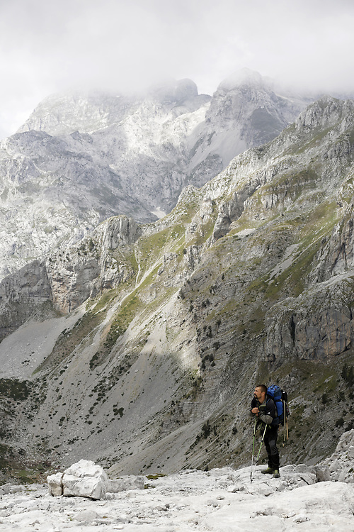 Climbiing to Maja Jezerce summit, Albania.<br /> <br /> From Summitpost:<br /> 55 miles long mountain range stretches in NW-SE direction,<br />  from the Scutari lake (Europe's largest cryptodepression) till the Mokra Gora mountain at the edge of  Kosovo polje field,   2/3 of the range still situated inside Albania.