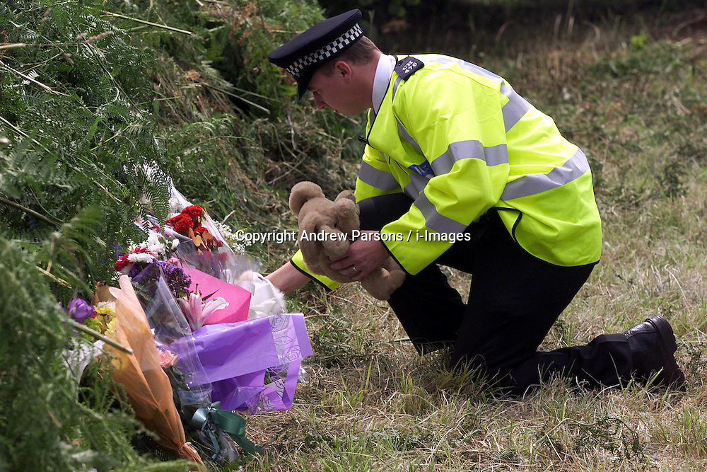 Flowers have been placed near to the field where Sarah Payne's body was found yesterday, July 18, 2000. Photo by Andrew Parsons / i-Images.