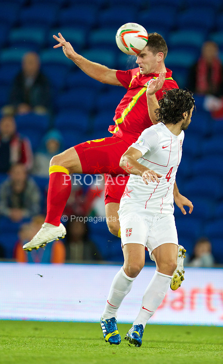 CARDIFF, WALES - Tuesday, September 10, 2013: Wales' Sam Vokes in action against Serbia during the 2014 FIFA World Cup Brazil Qualifying Group A match at the Cardiff CIty Stadium. (Pic by David Rawcliffe/Propaganda)