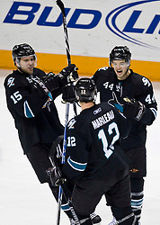January 21, 2010; San Jose, CA, USA; San Jose Sharks defenseman Marc-Edouard Vlasic (44) celebrates with center Patrick Marleau (12) and left wing Dany Heatley (15) after scoring a goal against the Anaheim Ducks during the second period at HP Pavilion. San Jose defeated Anaheim 3-1. Mandatory Credit: Jason O. Watson / US PRESSWIRE