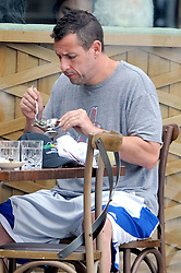 EXCLUSIVE: Adam Sandler uses a miniature gravy boat as he enjoys breakfast with his wife Jackie in Santa Monica, Ca. The comedian appeared to be filming a scene from one of his tongue and cheek films as he used the tiny gravy boat to dip his food into during a morning breakfast with his wife. Sandler brought along his Bulldog 'Meatball' for the occasion who sat patiently underneath his seat. 21 Sep 2016 Pictured: Adam Sandler. Photo credit: Atlantic Images / MEGA TheMegaAgency.com +1 888 505 6342