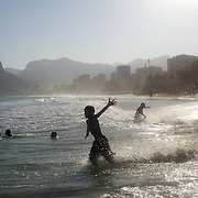 A beach scene at Ipanema Beach with the twin peaks of Dois imaos in the distance. Rio de Janeiro, Brazil. 8th August 2010. Photo Tim Clayton..