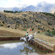 Bernie Hewitson riding Pinot Gris in action at the water jump during the Cross Country event at the Wakatipu One Day Horse Trials at the Pony Club grounds,  Queenstown, Otago, New Zealand. 15th January 2012. Photo Tim Clayton