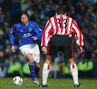 Photo. Aidan Ellis<br />Everton v Southampton. FA Barclaycard Premiership 22/02/03.<br />Everton Li Tie and Southampton Paul Telfer<br />.