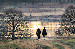 © Licensed to London News Pictures. 18/01/2019. London, UK. People walk in Richmond Park at first light as freezing temperatures and snow hit parts of the UK. Photo credit: Peter Macdiarmid/LNP
