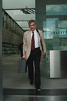 27 JUL 1999 - BERLIN, GERMANY:<br /> Michael Naumann, Staatsminister im Bundeskanzleramt, verläßt nach einer Pressekonferenz das Bundespresseamt<br /> Michael Naumann, Minister of Staate of the Department of the Federal Chancellor, after a press conference<br /> IMAGE: 19990727-01/03-14