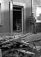 British soldier on duty outside the vacant house where a booby-trap killed  Philomena Green, 16 years, from Lurgan, N Ireland,  She was along with a friend, Joanne O'Hagan, who survived the blast. They entered the  vacant house, which was owned by Joanne's father, when they saw a light on. The Provisional IRA admitted they planted the bomb and apologised to the family. They claimed the house was being used by British soldiers as an observation post. 197611270522b..Copyright Image from Victor Patterson, 54 Dorchester Park, Belfast, United Kingdom, UK...For my Terms and Conditions of Use go to http://www.victorpatterson.com/Victor_Patterson/Terms_%26_Conditions.html