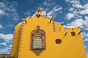 The facade of the Aranzazu Chapel and San Francisco Convent in the Plaza de Aranzazu in the state capital of San Luis Potosi, Mexico. The chapel and convent was built between 1749 and 1760 and features Churrigueresque details and tiled domes.