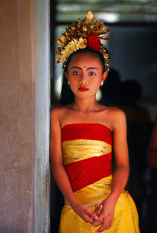 Young Balinese dancer at school cultural performance, Peliatan, Bali, Indonesia