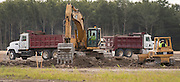 Construction crews work on the site for the new North Forest, July 15, 2015.
