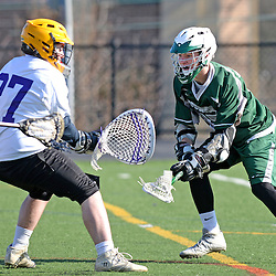 Staff photos by Tom Kelly IV<br /> Bonner-Prendie's Brendan Kelly (17) shoots and scores past Upper Darby goalie Casey Kester (27) during the Upper Darby at Bonner-Prendie boys lacrosse game on Monday, March 23, 2015.