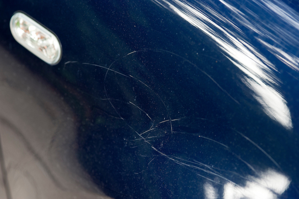 "On July 30, 2011, the signature work of ""rock"" artist Holden Miller, 4, was discovered as a series of seven frenetic scratches etched with rocks into the paint of multiple panels of a blue VW Jetta, the car belonging to the boy's father, Jeff Miller. The Miller/Stute family lives in Madison, Wis., and all are doing their best to remain calm. Holden continues to ask his father, ""You still love me, right?"" Yes, I still love the boy."
