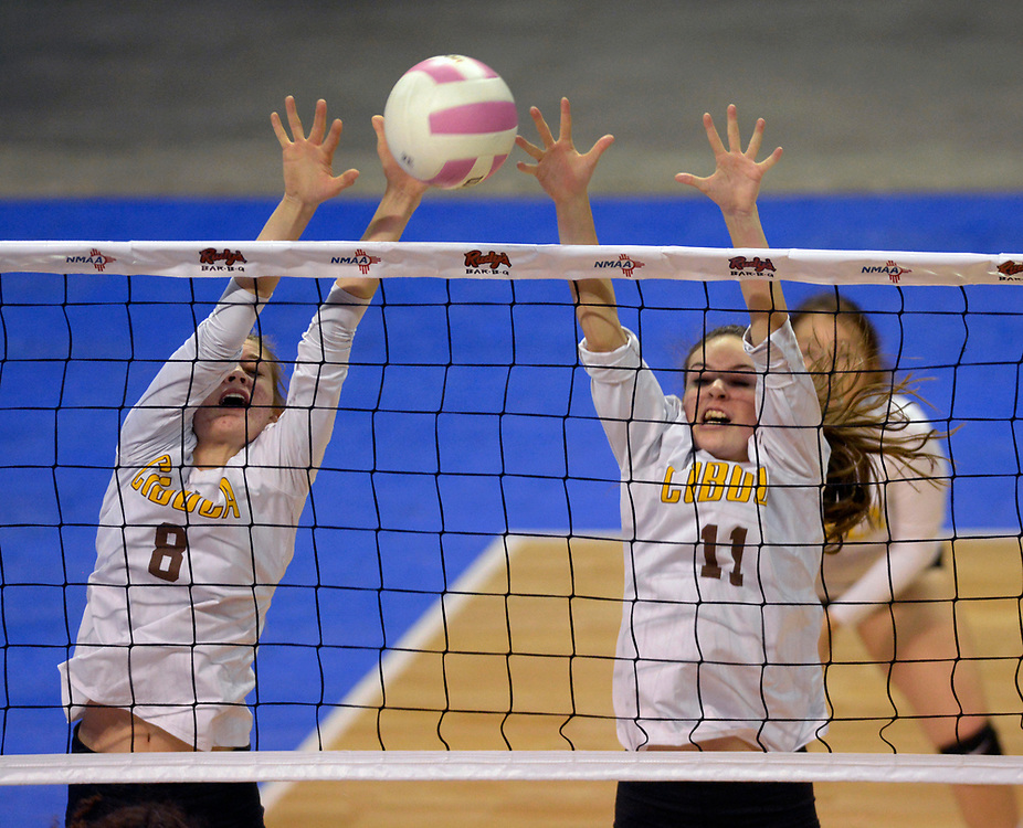 gbs110917e/SPORTS --  Cibola's Emma White, 8, and Lillian Reimer, 11, jump to block during game against Eldorado in the State Volleyball Championships at the Santa Ana Star Center on Thursday, November 9, 2017. (Greg Sorber/Albuquerque Journal)