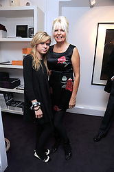 Left to right, SCARLETT CARLOS CLARKE and her mother LINDSEY CARLOS CLARKE at a private view of 'Most Wanted' an exhibition of photographs held at The Little Black Gallery, Park Walk, London on 27th November 2008.