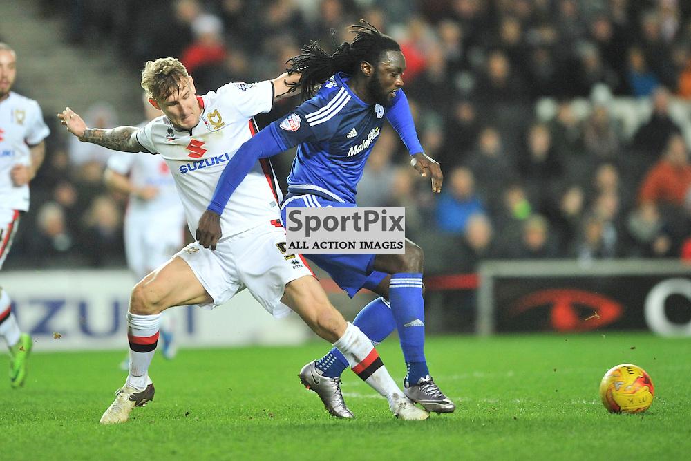 Cardiffs Kenwyne Jones attacks MK Dons Kyle McFadzean,  MK Dons v Cardiff, Sky Bet Championship, Saturday 26th December 2016