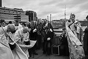 Bishop of Lambeth conducting prayers, wearing cloak made from incorporating flotsam from the river, , The Blessing of the river, St. Magnus the Martyr and Southwark Cathedral join on London Bridge to Bless the river Thames. 13 January 2019