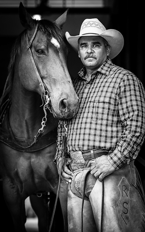 "King Ranch Pure Bred Unit Manager and Cowboy Robert Silguero with his horse 'Signs""."