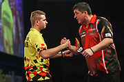 Mensur Suljovic congratulates Dimitri Van den Bergh on his victory during the PDC World Darts Championship at Alexandra Palace, London, United Kingdom on 28 December 2017. Photo by Shane Healey.
