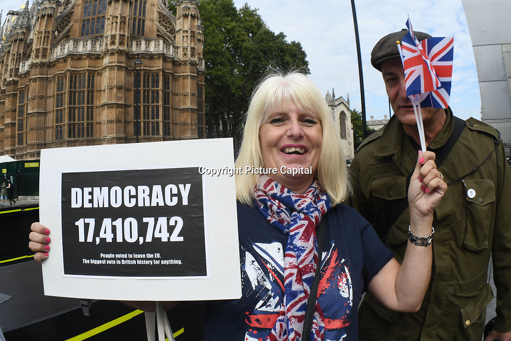 Pro-Brexit holding placard to Block Parliament & the Brexit Betrayal! march in Westminster, London, UK. 5th September 2018.