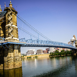 Picture of John A. Roebling Bridge in Cincinnati Ohio. The John A. Roebling Suspension Bridge was built in 1865 and crosses the Ohio River connecting Covington Kentucky with Cincinnati Ohio. The image is high resoution and was taken in July 2012.