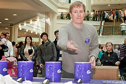 "Cadburys Spots vs Stripes Challenge Race Season Meadowhall Sheffield.Nick Icke tries his hand at being the ""fastest tea maker"".2 April 2011.Images © Paul David Drabble"