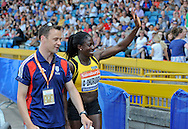 Picture by Alan Stanford/Focus Images Ltd +44 7915 056117<br /> 12/07/2013<br /> Christine Ohuruogu pictured waving to the fans after her 400m win during day two of Sainsbury's British Championship at Alexander Stadium, Birmingham.