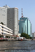 A Sheraton hotel stands next to a tall modern office building on the Chao Phraya river in Bangkok, Thailand. The Chao Phraya river is a major transportation artery for a vast network of river buses, cross-river ferries and water taxis, also known as longtails. More than 15 boat lines operate on the rivers and canals of the city, including commuter lines. Maenam (river) Chao Phraya, is a major river in Thailand, with its low alluvial plain forming the center of the country. It runs through Bangkok, the capital city, and then empties into the Gulf of Siam.