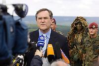 07 JUN 2006, MERZIG/GERMANY:<br /> Franz Josef Jung, CDU, Bundesverteidigungsminister, waehrend einer Pressekonferenz, im Rahmen eines  Truppenbesuchs beim Luftlandeunterstuetzungsbataillon 262 - das Bataillon gehoert zur Luftlandebrigade 26, die am Einsatz der Bundeswehr im Rahmen der EU Mission EUFOR RD Congo teilnehmen wird - Truppenuebungsplatz<br /> IMAGE: 20060607-01-054<br /> KEYWORDS: Mikrofon, microphone, Kamera, Camera, Soldat, Soldaten