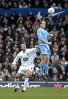 Photo. Glyn Thomas.<br /> Leeds United v Tottenham Hotspur. Premiership. <br /> Elland Road, Leeds. 10/01/2004.<br /> Spurs's Gary Doherty (R) leaps higher than Mark Viduka to gain possession.