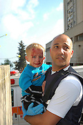 Israel, Haifa, An apartment building hit by a missile March 30th 2006 Emergency response team taking care of a young boy