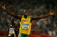 BEIJING, CHINA:  Usain Bolt  celebrates after winning the gold won medal in the 200 meters during the 2008 Olympics in Beijing, China. ©2008 Johnny Crawford